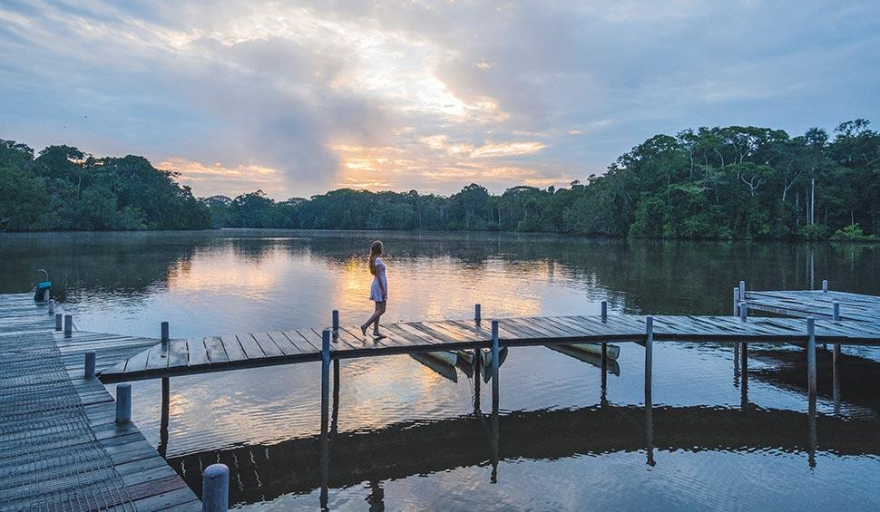 woman walking on the pier - la selva lodge
