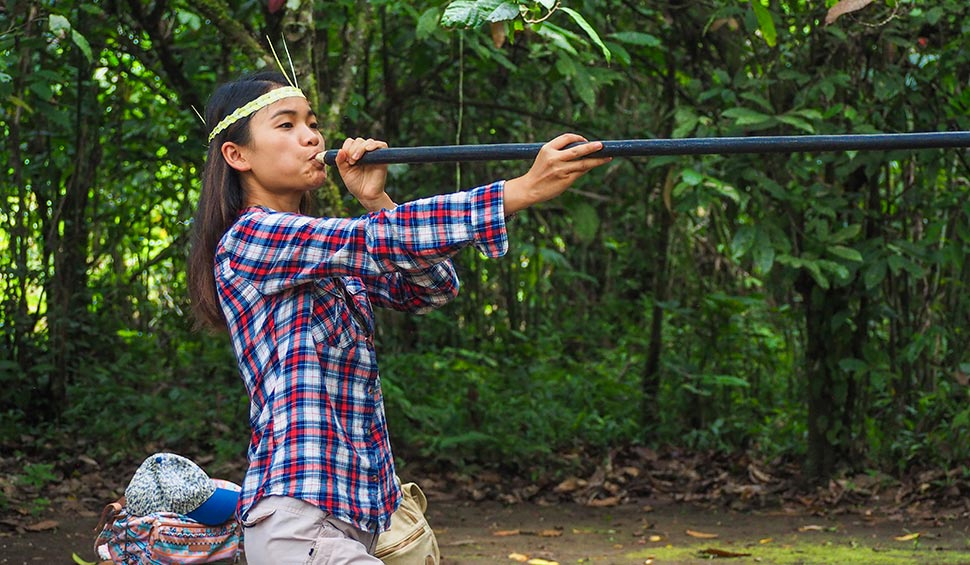 tourist woman using the blowgun