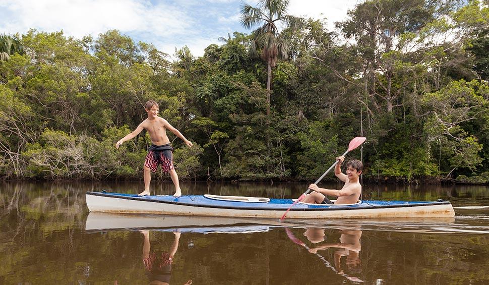 kids on a kayak - la selva lodge