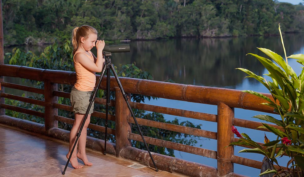 girl observing the amazon nature