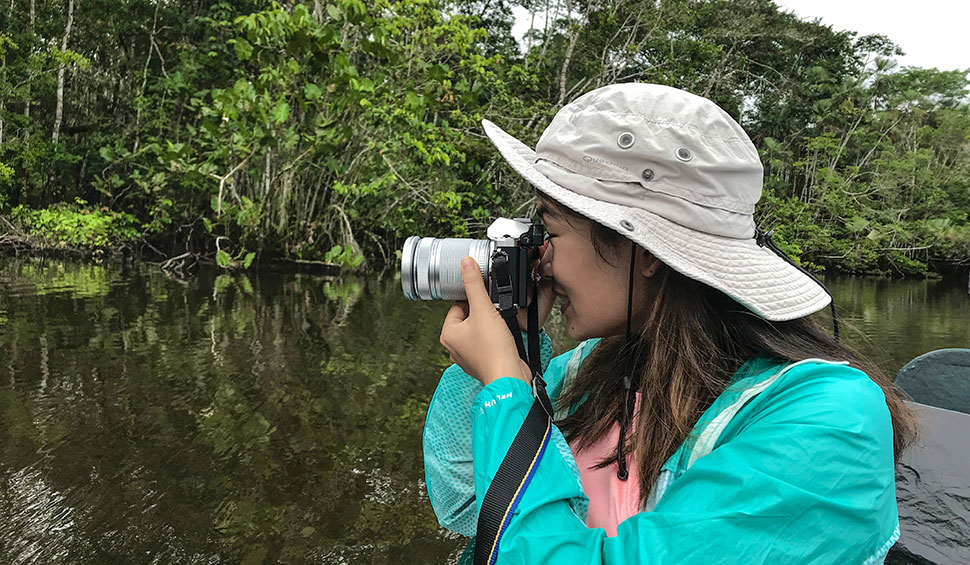 girl taking a picture in the amazon jungle